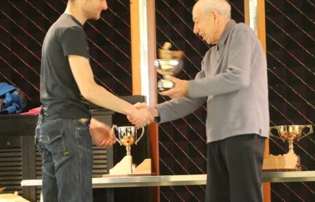Sam Clark receiving one of his trophies from Tony Millington.