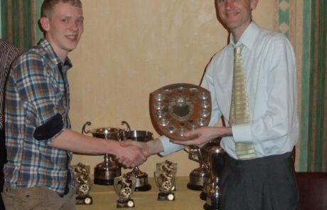Sam Garner being presented with the Junior BAR Trophy