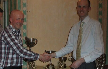 Steve I'Anson being presented with the Len Eyre Trophy
